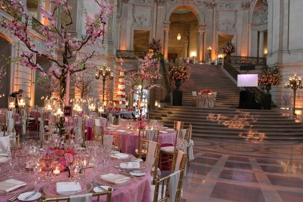 Wedding reception with pink cherry blossom trees.
