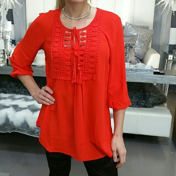 """'EMBER' tunic top NWT Brand new with tags Gorgeous and vibrant red top! Lovely details on the front. Breezy and loose fitted style.  Material 100% polyester Threaded Lace detailing on front 100% cotton Length approx 28"""" long in front and back, curves up on sides ( pic 3 side view) Tops"""