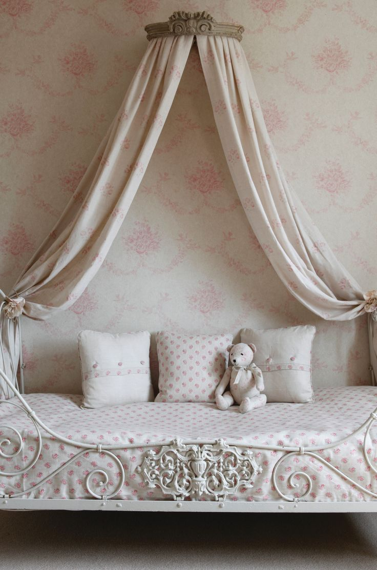 This French style bed with a pediment canopy is perfect for a little girl.s bedroom.