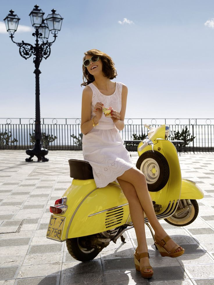 VESPA~GIRL ON YELLOW VESPA.