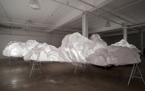 Behind layers of scrunched-up tissue paper, the installation was filled with motion-sensitive devices that triggered a system of concealed lighting.