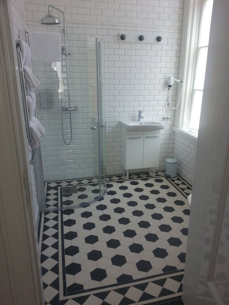 Victorian Floor Tiles - Original Style. Here's another shot from a project we completed in Sweden. A beautiful monochromatic scheme is complemented with white metro style tiles. Black and white never goes out of fashion! originalstyle.com