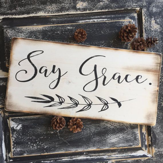say grace - rustic, farmhouse style wooden sign painted in black distress over a white distressed board.  This sign is 12x 20. Size may vary by 1. The back is unfinished and comes with wall hangers.  Please note this is a made to order listing, so please be aware of the processing time.  If you would like custom colors, please message us prior to purchasing.  Be sure to check out our other listings! We hope you love our items and if you have any questions, please dont hesitate to send us a…