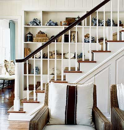 Built-in shelves and interesting art objects give this staircase big personality. myhomeideas.com