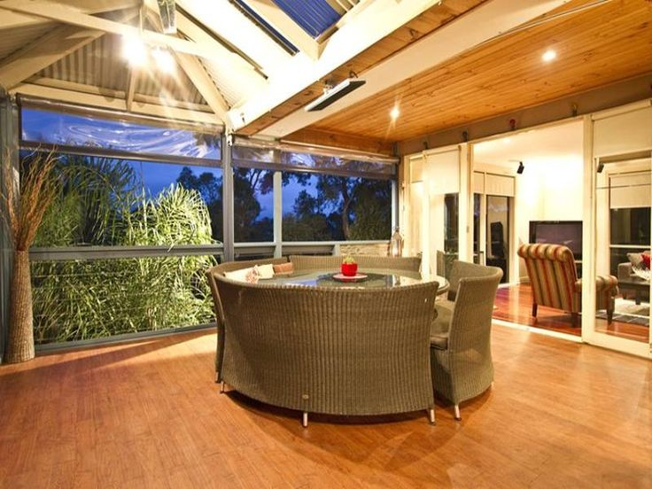 Indoor-outdoor outdoor living design with bbq area & decorative lighting using timber - Outdoor Living Photo 441552