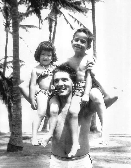 "Elvis playing with the child actors on the set of ""Blue Hawaii"" 1961."