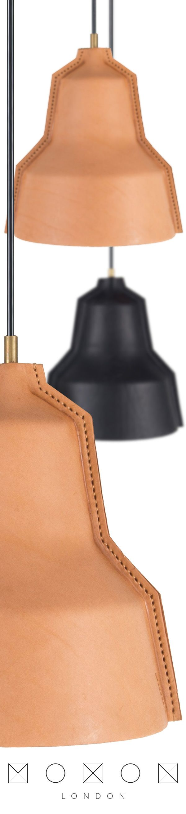 Hand stitched leather lamp shades with brass fittings from MOXON London. These beautiful leather lamps have been hand crafted by artisans using the finest leather.  Available in natural tan and black leather.
