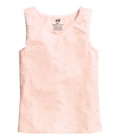 Pajama tank top in soft cotton jersey with a printed design. Narrow lace trim at neckline and armholes.