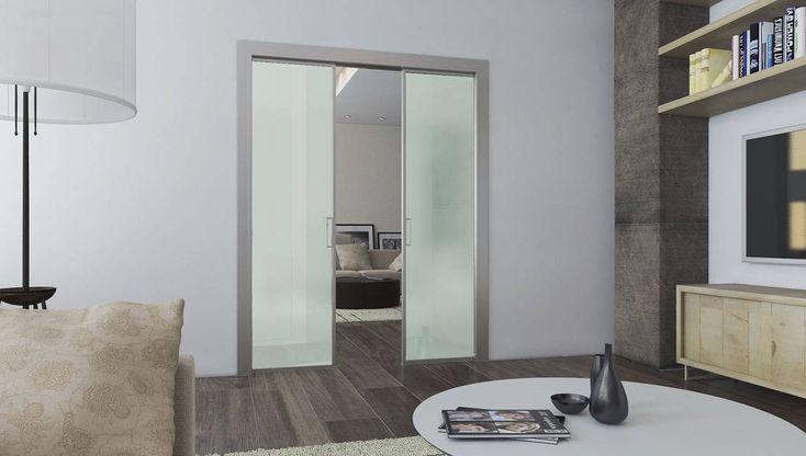 La porta scorrevole #Scrigno Acqua si distingue per la sua linea semplice e moderna in cui il sottile profilo di alluminio esalta le ante in vetro. Con soli 40mm di spessore offre grande versatilità ed ottime doti di solidità. #revolutionscrigno #porte #vetro #design #interiordesign #arredamento