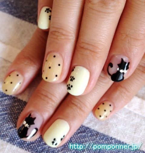 black cat beige dotted nails