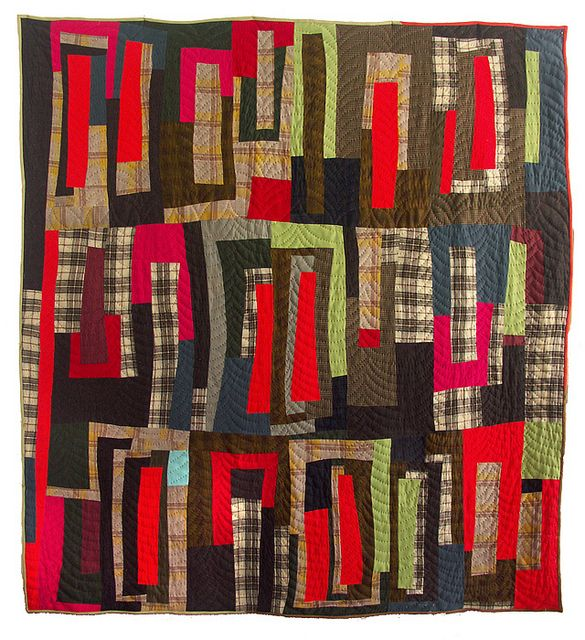 wool quilt from repurposed garments - pattern is inspired by the symbol of brackets - [ ] - hand quilted