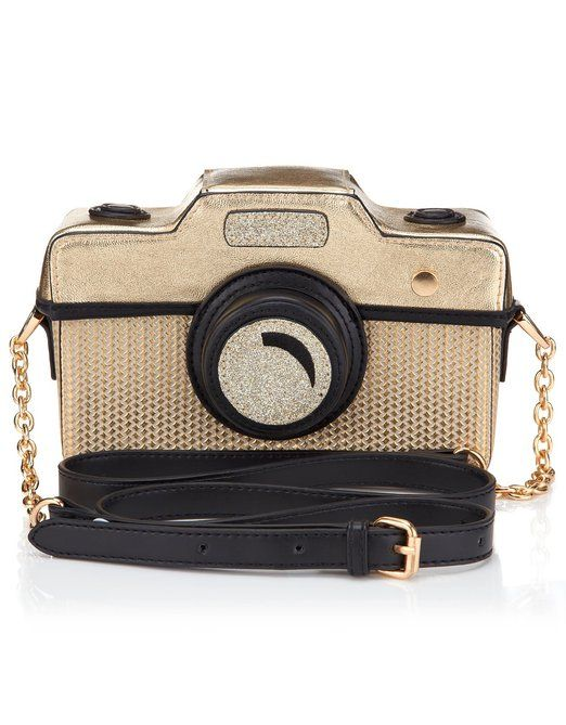 Cute quirky bags :) the camera and the grapefruit are stellar