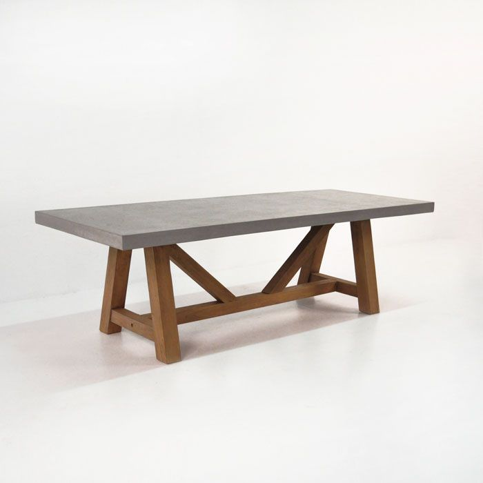 Our most amazing and popular dining table by far. Reclaimed Teak wood makes a bold statement with our raw concrete table top. Both materials perfectly suit
