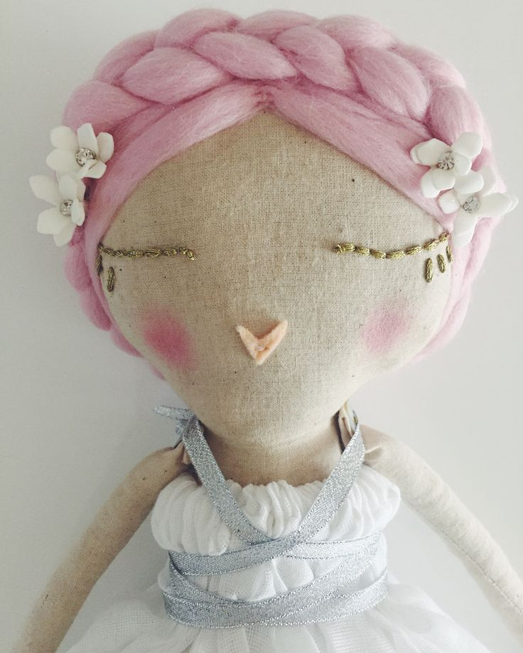 READY FOR HER NEW FOREVER HOMEHandmade heirloom cloth doll.Pink haired doll wearing white and diamanté flowers in her hair. Dressed in a white butter cotton elasticated dress, tied with a silver metallic ribbon. With matching leg ties. The ribbon isn't attached, so the dress can also be worn plain.Each doll is hand dyed in tea  to create variations in skin tones and stuffed with eco friendly fibre stuffing. They are all made of cotton and clothed in new and recyc...