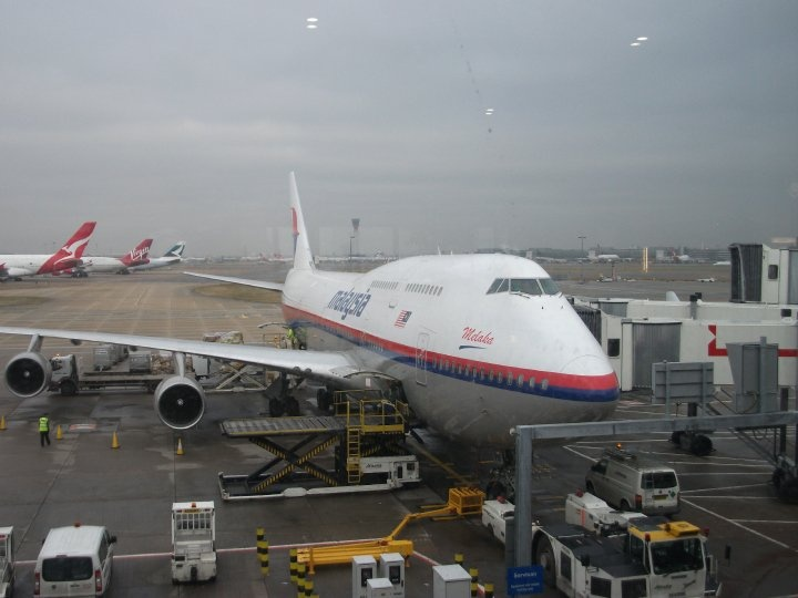 Malaysia Airlines 747-400 named Melaka, waiting at Heathrow Airport terminal 4 going to Kuala Lumpur.