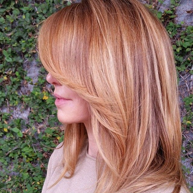 """You know you just said """"Oooh!"""" out loud when you saw this!  This strawberry blonde perfection is brought to you by @balayagebyadriana. Believe it or not, those are some extensions you see in there. They're compliments of @extbymissbrown and @razextensions.  And hold up! That sleek, long layered cut is by @jasminsmaneattraction!  Sometimes it takes a village... A FABULOUS village!"""