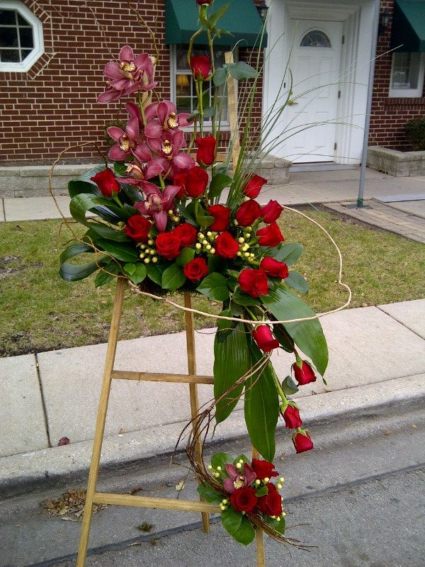 Funeral Arrangement -- Red Roses and Red Orchids