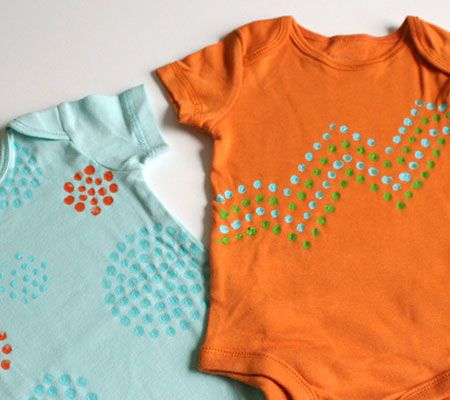 This is a great baby shower game that's simple and fun for the whole group. Use solid-colored bodysuits and fabric paint to create geometrically-designed, polka dot outfits that are perfect for baby girls or boys.
