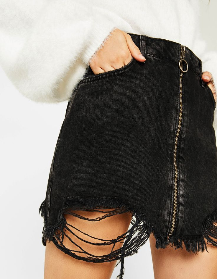 Frayed denim skirt with zip. Discover this and many more items in Bershka with new products every week