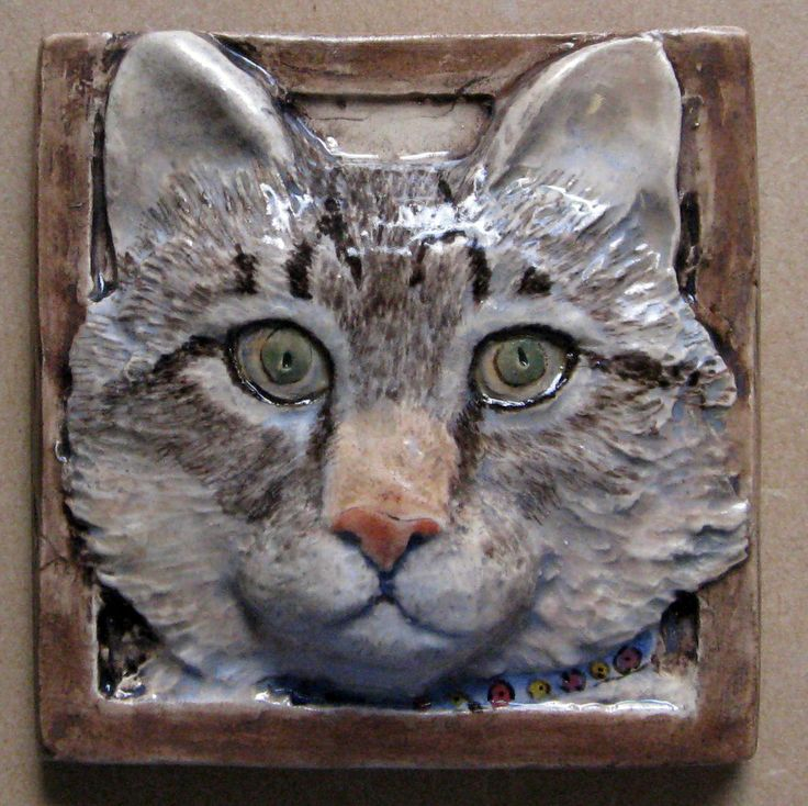 "ceramic cat tile 4x4"" with green eyes. $32.00"