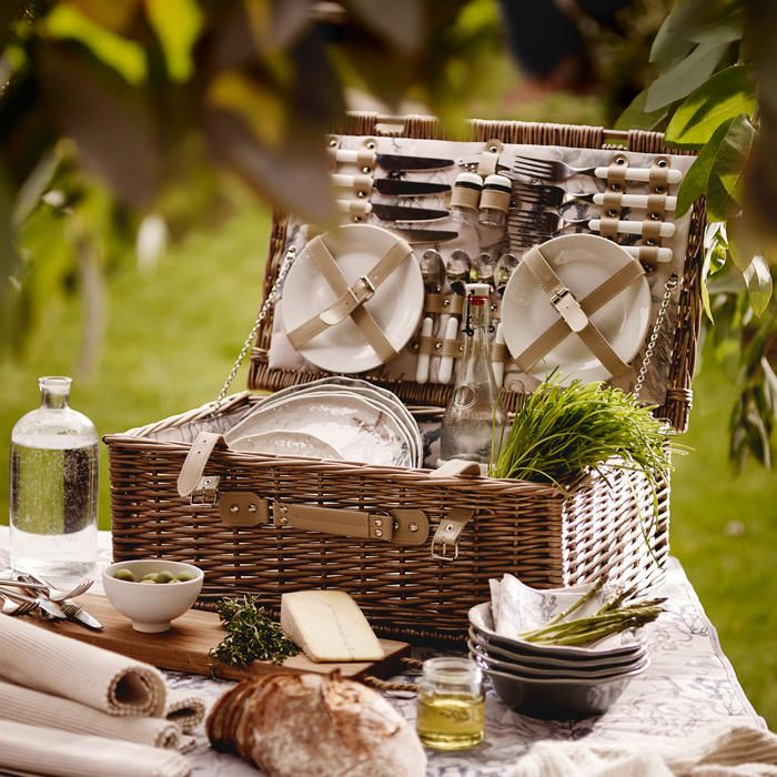 A picnic hamper packed with picnic plates