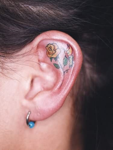 Yellow Rose Tattoo Inside Ear but of course if I were to ever get this it would be a red rose haha