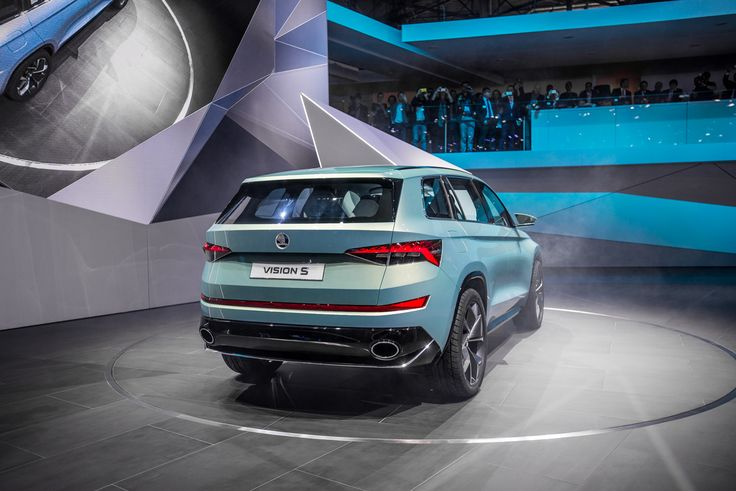 The rear of the ŠKODA VisionS is sculpturally shaped.  The number plate recess tapers rearwards; a powerful diffuser inset, which surrounds the large, elliptical exhaust pipes, provides the SUV show car with a strong visual stance on the road #VisionS #Geneva2016