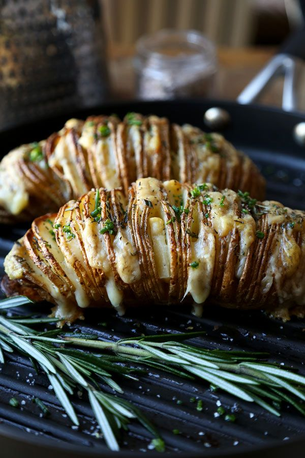 This Sliced Baked Potato (Hasselback) Recipe comes with melted gruyere cheese, chives and freshly chopped rosemary. They are salty, savory & so comforting!