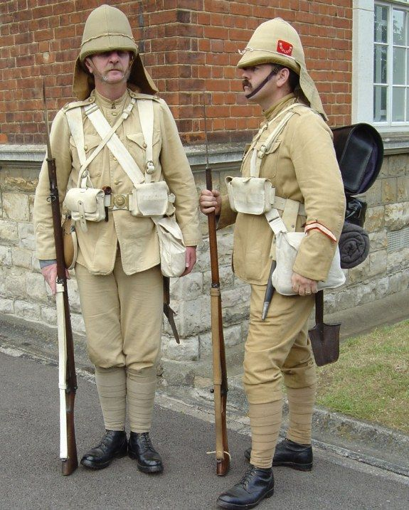 British Anglo-Boer War Kit at the start of the Second Boer War. Regiment represenrted being the Middlesex(see helmet flash). Note the long service stripe worn by the re-enactor on the right. If it had really been sewn on in such a shoddy fashion his sergeant would have kicked his arse from one end of the parade ground to the other and then taken the stripe off him..