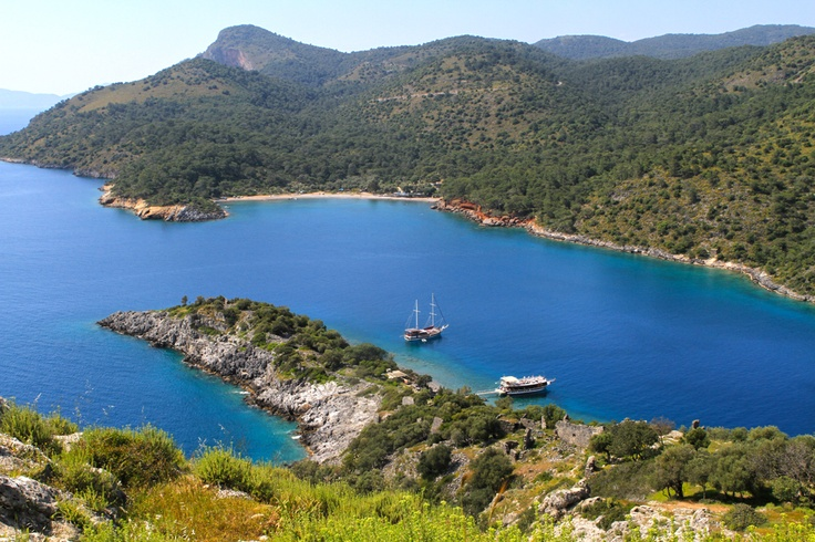 """View from St. Nicholas Island to Turkish mainland. Our Gullet """"Finke"""", moored in the bay."""