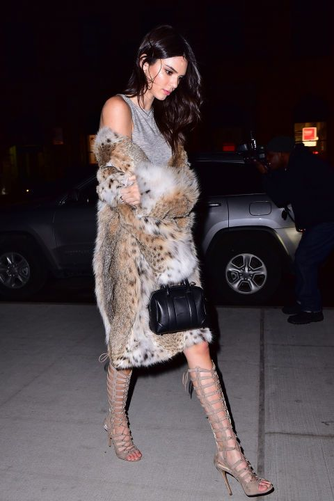 Attending the launch of her new clothing line, Kendall dressed up a grey Kendall + Kylie t-shirt dress with a chic fur jacket, Givenchy bag, and Kendall + Kylie lace-up heeled sandals.
