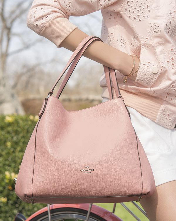 The blush Edie shoulder bag makes a summer statement when worn with shades of pink.  #armcandy