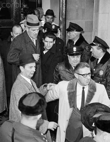 Albert DeSalvo, the Boston Strangler, is escorted out of Lynn Police Station to be taken to Walpole State Prison. He was captured in a West Lynn uniform store after escaping from Bridgewater State Hospital.