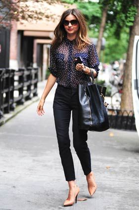navy blue sheer white polka dotted blouse, high waisted black jeans, colored pumps, signature sunglasses