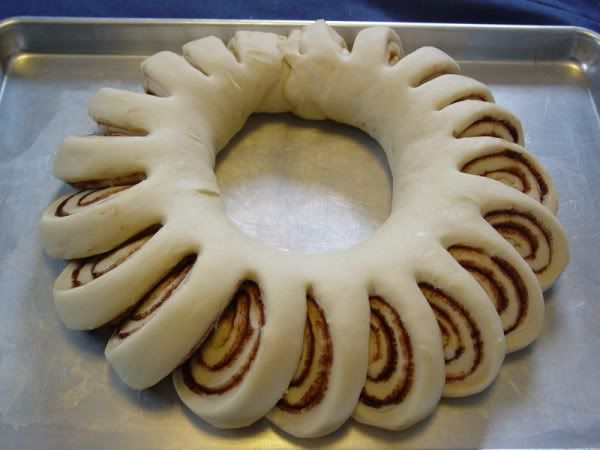 Christmas cinnamon roll wreath. Frosting in the middle for pull apart and dip! Perfect for breakfast on Christmas morning!