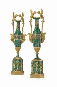 A PAIR OF RUSSIAN ORMOLU-MOUNTED MALACHITE VASES  ST. PETERSBURG, CIRCA 1800  Each with applied anthemia and flanked by putto caryatid and griffin-formed handles, the malachite relaid with a later composition and metal core, possibly originally conceived with patinated bronze bodies  21¼ in. (54 cm.) high (2)
