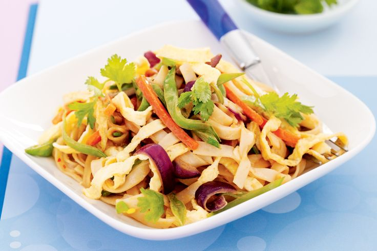 Pad Thai noodles tossed with vegetables and peanut butter make a speedy meal.