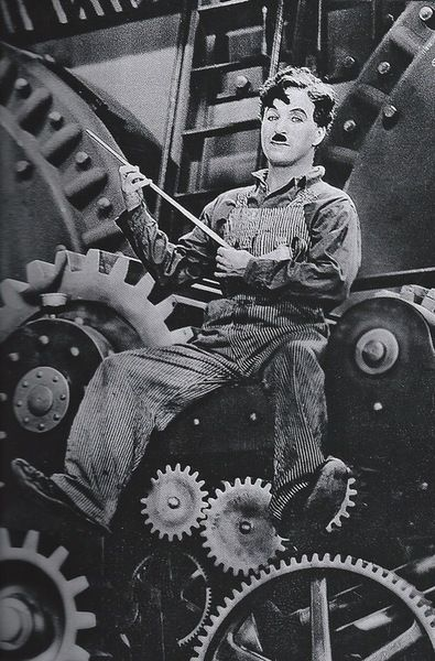 Charlie Chaplin in Modern Times c.1936 He kind of looks like Robin Williams here.