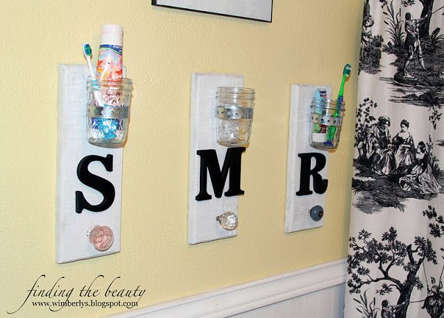 mason jar holders for each kid's toothbrush and toothpaste, then instead of knobs I would use a two hook