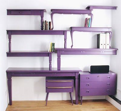 To DIE for Bookshelves!  I love the idea of putting different brightly colored coffee tables to make one wall unit. Strikes me as very Wonderland.