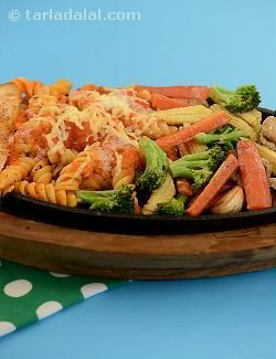 Sizzlers are a great addition to a dinner menu, especially for parties. Served steaming hot, they tempt the diners with the surge of fresh flavours and amalgam of aromas that is reflective all the ingredients in the sizzler. This italian sizzler is a recipe par comparison that combines nutritious veggies like carrots, broccoli and baby corn with luscious cheese, cream and pasta. It is a treat that pampers the taste buds, while also serving as a wholesome meal that satiates your hunger!