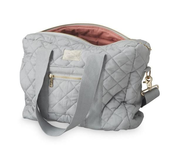 If you want a stylish changing bag the Cam Cam Nursing bag is one of the best. The quilted changing bag comes in grey with a pink lining and is 100% organic