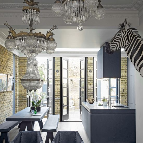 Grey kitchen with brick accents