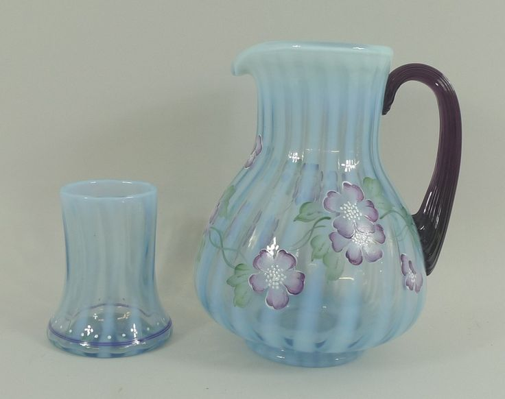 Batemans Auctioneers: Bill Fenton 75th Diamond Jubilee opaline and clear glass water jug set enamel decorated and painted with flowers, printed marks, jug 18cm high, glass 9cm high.