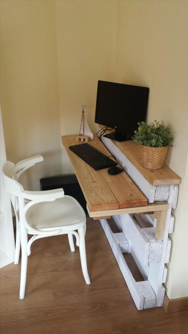 Make your own table top with reclaimed wood to create a desk surface.