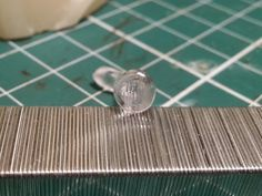How to make a clear headlight lens for scale models.