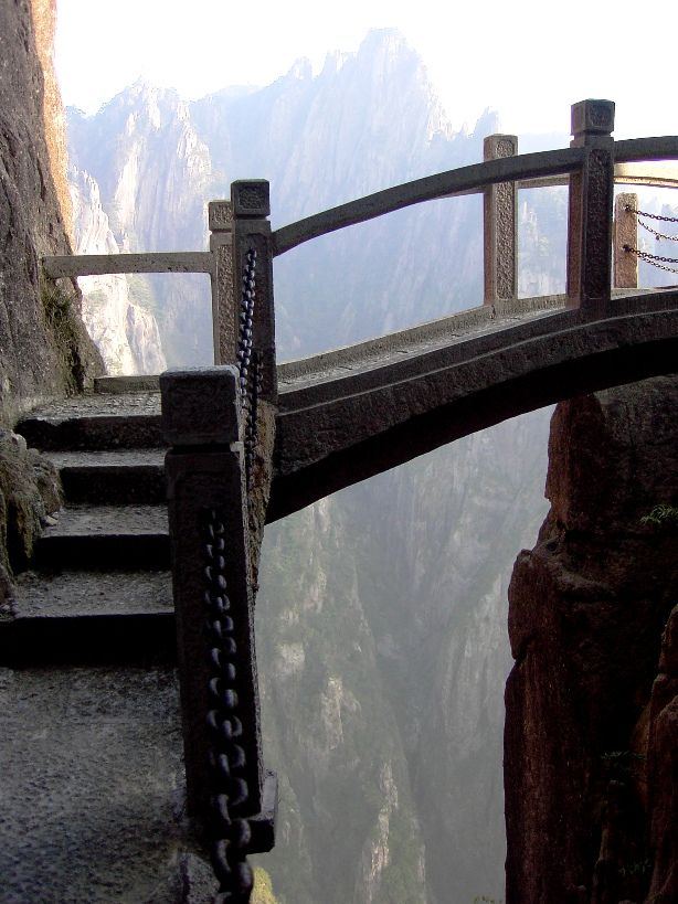 "Mountain Bridge, Anhui Province, China.  ...Photo of the stairs from China's Fairytale Terror Trail in Huangshan Mountains.The trail/bridge has 10,000's granite steps, lacks occasional rails, and is generally ""open"" for the thrill of the hike."