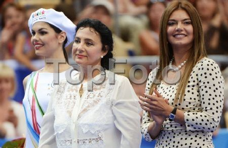 2246206 Russia, Kazan. 07/16/2013 Member of RF Duma Committee for Physical Education, Sports and Youth Affairs Alina Kabaeva, right, and President of the Russian National Rhythmic Gymnastics Federation Irina Viner-Usmanova, in the center, during the medal ceremony in rhythmic gymnastics at the 27th World University Summer Games in Kazan. Vladimir Vyatkin/RIA Novosti