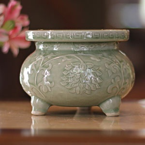 """Novica """"Thai Forest"""" Celadon Ceramic Incense Burner from World Market - I'd love some incense burning in the bedroom. Something musky would be the best scent to choose."""