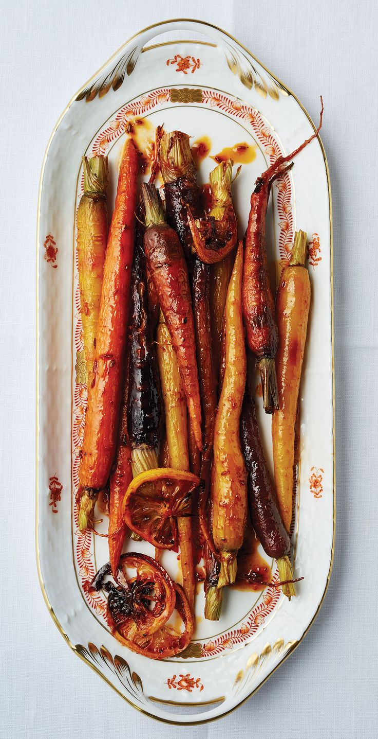 Harissa and maple syrup add the perfect amount of spicy and sweet to these carrots.